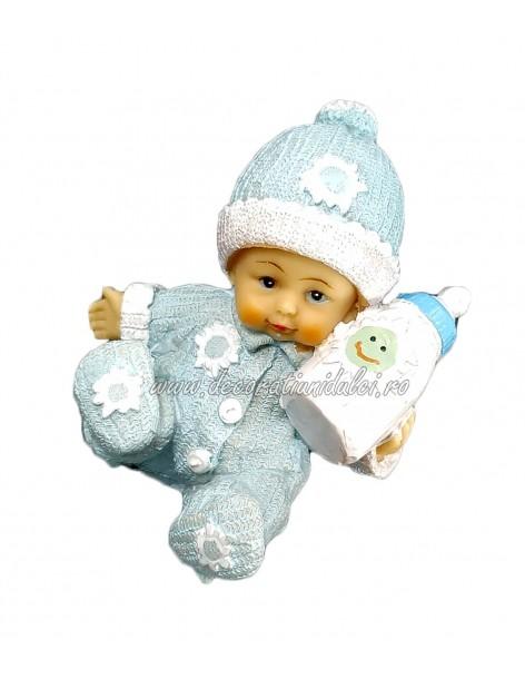 Figurine boy with bottle